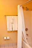 Towels and shower in bathroom Stock Images