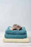 Towels with soap bars Stock Images