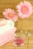 Towels, soap, candle and flowers. Royalty Free Stock Photography