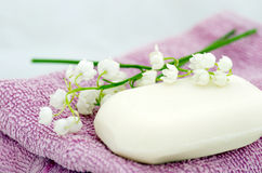 Towels, soap and lilies Stock Photos