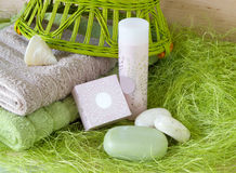 Towels, soap, shampoo. Still life. colored towels, soap, shampoo on a green background Royalty Free Stock Images