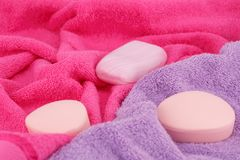 Towels and soaps. Colorful towels and soaps closeup picture Royalty Free Stock Photo