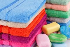 Towels and soaps. Colorful towels stacks and soaps closeup picture Stock Photo