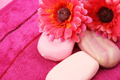 Towels, soaps, flowers Stock Photos
