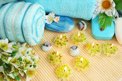 Towels, soaps, flowers, candles Royalty Free Stock Image