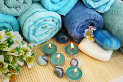 Towels, soaps, flowers, candles Royalty Free Stock Photography