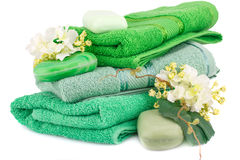 Towels, soaps and flowers Royalty Free Stock Photos