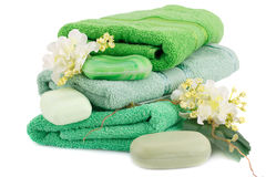 Towels, soaps and flowers Royalty Free Stock Image