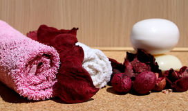 Towels and soaps. With some potpourri Stock Photos