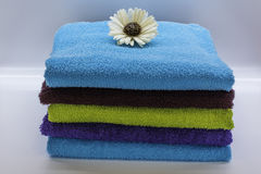 Towels in the spa 1. Colours towels in the natural and relax spa Stock Photos