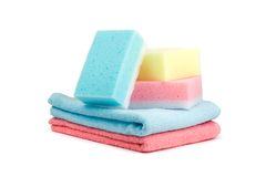 Towels and sponges. Colored bathroom towels and sponges. Isolated on white Royalty Free Stock Photography