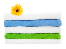 Towels stack with flower on white background Royalty Free Stock Photography
