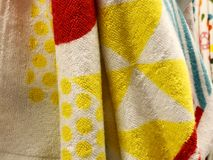Shower towels. Terrycloth towels in pile for selling. Home decor cloth in department store. Terry towels vertical pile on shelf. Royalty Free Stock Photo