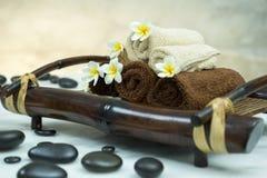 Towels&stones&frangipani 图库摄影