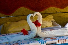 Towels swans. Towel swans left by a hotel room service Royalty Free Stock Photos