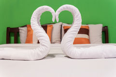 Towels swans on white bed Royalty Free Stock Photo