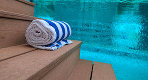 Towels at swimming pool Stock Photo