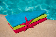 Towels at the swimmingpool Stock Photo