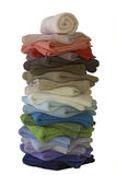 Towels. Tall stack of towels in different colors. Sales Royalty Free Stock Images