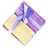 Towels tied white ribbons placed in the basket. Royalty Free Stock Photo