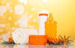 Towels and toiletries in the bathroom on an abstract yellow Royalty Free Stock Photography