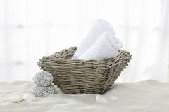 Towels, towel rolls in the basket Royalty Free Stock Images