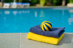 Towels and toys near the swimming pool Royalty Free Stock Image
