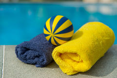 Towels and toys near the swimming pool Stock Image