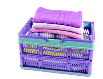 Towels washed in plastic crate Royalty Free Stock Photography