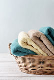 Towels in wicker basket Royalty Free Stock Photo