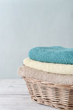 Towels  in a wicker basket Stock Images