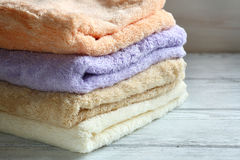 Towels on wooden boards Stock Photography