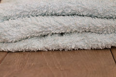 Towels on a wooden table Royalty Free Stock Image