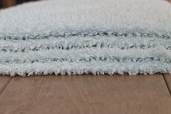 Towels on a wooden table Royalty Free Stock Photography