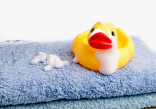 Towels and a yellow duck Stock Images