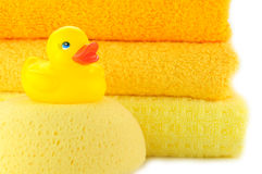 Towels and Yellow rubber duckies. Bath accessories. Bath towels and Yellow rubber duckies Royalty Free Stock Photos