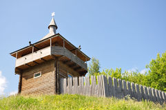 Tower. Modern reconstruction of the watchtower and wooden ramparts of the fortress stock photography