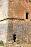 Tower. A closeup of one side of an old Norman tower in Sicily, Italy Royalty Free Stock Images