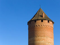 Tower. Old tower of Sigulda Castle (Latvia, 13th century) against a background of clear blue sky Royalty Free Stock Photo