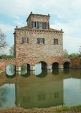 Tower of abbot scooping. Old construction in comacchio (italy) used to scoop the water.the original name is \torre dell\'abate Stock Photo