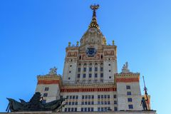 Tower above entrance to main building of Lomonosov Moscow State University MSU on a blue sky background Royalty Free Stock Image