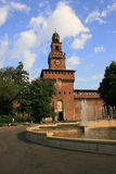 Tower against sky. The Sforza Castel entrance main tower and fountain against a beautiful sky Stock Photo