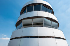 Tower of airport with large windows against blue sky Royalty Free Stock Photo