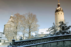 Tower in Altenburg in the winter with snow. Tower Hausmannsturm and tower Flasche of the castle in Altenburg in the winter with snow Royalty Free Stock Photo