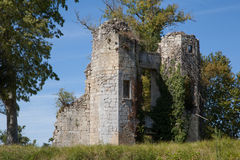 Tower  of the ancient castle, dark blue sky in background. Royalty Free Stock Photo