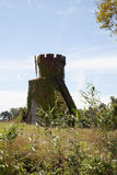 Tower of the ancient castle, dark blue sky with clouds in background. Royalty Free Stock Images