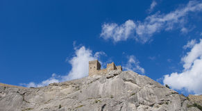 The tower of the ancient castle on a rock Royalty Free Stock Image