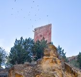 tower of a ancient castle in a small village called Villel in Teruel / Spain at the sunrise in the morning. Many doves flying stock photography