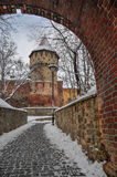 Tower through the arch. Defense tower in Sibiu, Romania, Winter Royalty Free Stock Photo