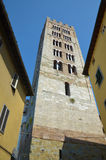 The tower of the Basilica of San Frediano, Lucca, Italy. The tower of the Basilica of San Frediano, Lucca, has openings that graduate in number, typical of Royalty Free Stock Images